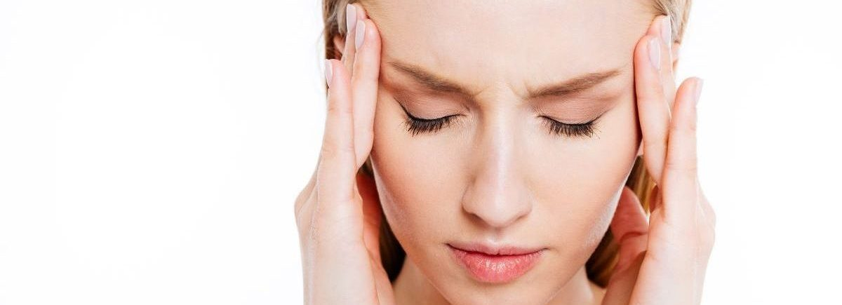 ból głowy przed okresem